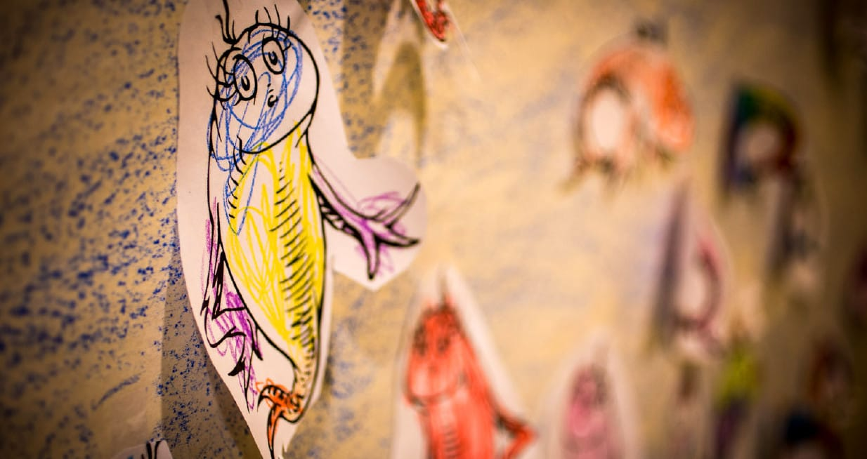 A picture of cartoon fish on a wall.