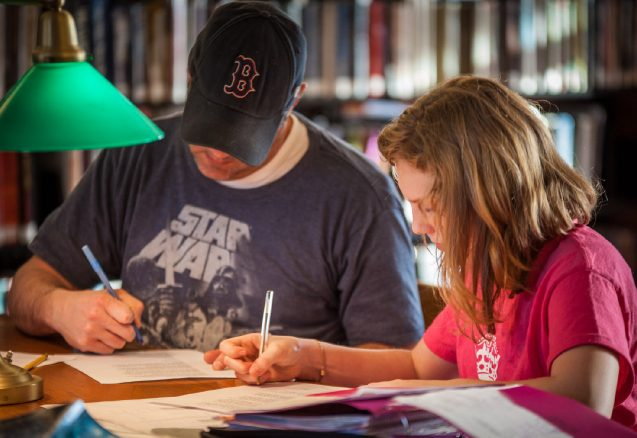 A picture of a father and daughter working.