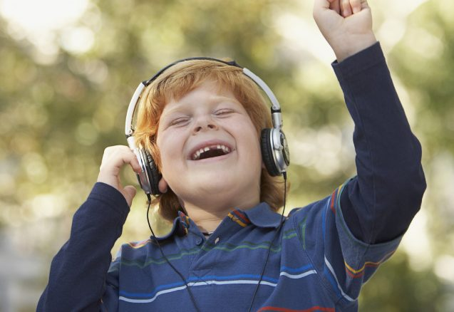 A picture of a kid with headphones on.