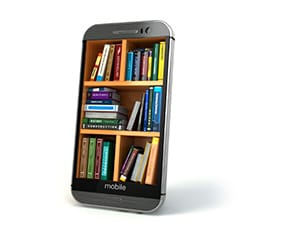 A picture of a mobile phone with books in it.