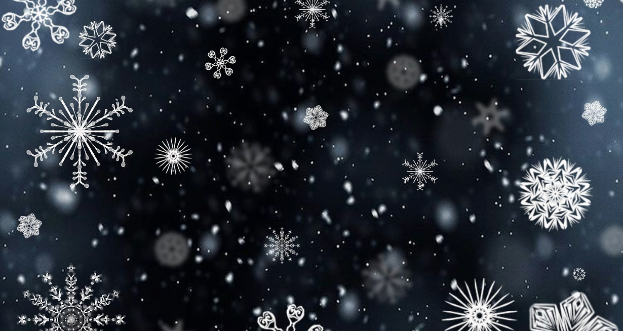 Snowflakes falling on a dark blue/black background