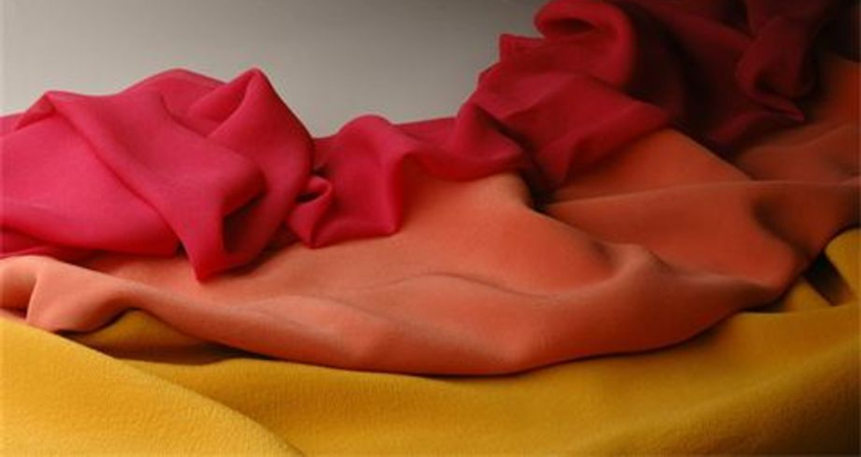 A red, yellow, and orange scarf on a table
